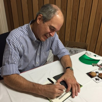 Children's author Peter Lerangis autographs a book for Litchfield Middle School.